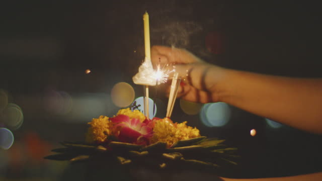 Loi Krathong the festival in Bangkok ,4k slo mo Thais people light the candle on Krathong in the festival of light CU shot 4k slo mo, Shot on RED dragon with IPP2 workflow lamp shade stock videos & royalty-free footage