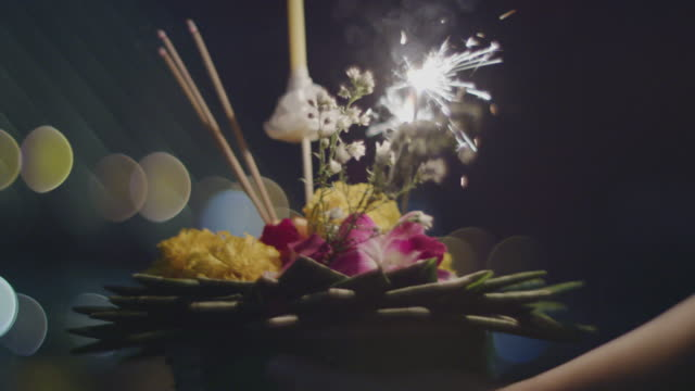 Loi Krathong, the festival of light , 4k slo mo Thais people praying to the water goddess in full moon night CU shot 4k slo mo, Shot on RED dragon with IPP2 workflow lamp shade stock videos & royalty-free footage