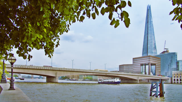 London bridge. The Shard. Tree. Riverside. Boat.