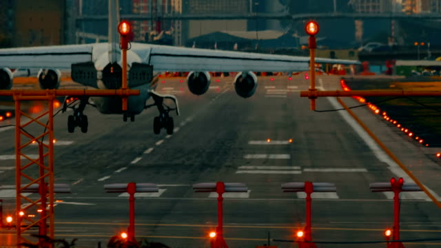 London City Airport - Ultra closeup showing the landing of a short-haul airliner with four turbofan engines video