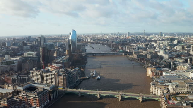 London city centre aerial panorama view: financial district, Thames river, Belfast, skyscrappers, warf and buildings and St. Pauls Cathedral, Tower Bridge and The Tower