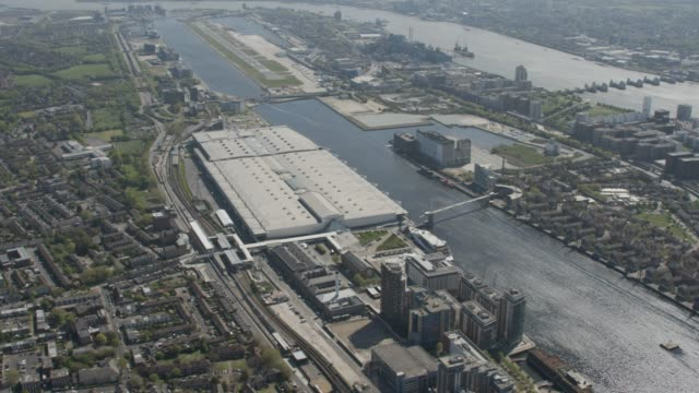 London in Lockdown - Helicopter / Aerial view of NHS Nightingale Hospital, part 1. April 2020 Aerial view of London during the coronavirus / COVID-19 lockdown. Featuring the NHS Nightingale Hospital at the ExCeL London, part 1. Filmed in April 2020. nhs stock videos & royalty-free footage