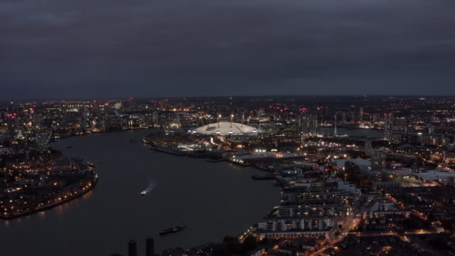 london riverside skyline aerial night view feat. river thames and the o2 arena - england stock videos & royalty-free footage