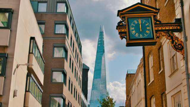 London Street. Clock. The Shard. House. Business downtown. Residental house.