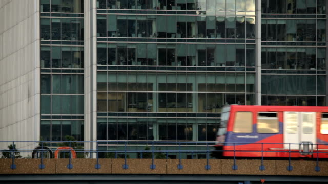 London underground (DLR) between South Quay and Heron Quays stations, Canary Wharf in esat London video