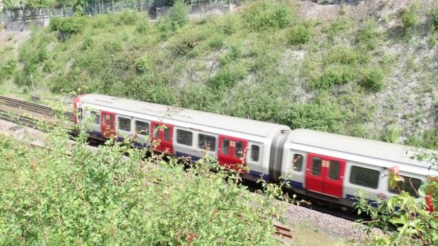 London Underground train in railway cutting, Chorleywood, Hertfordshire video