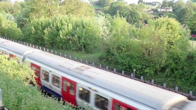 London Underground train passing by in Hertfordshire countryside video