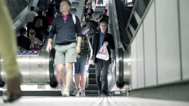 London Westminster Underground Station - People walking off Escalators video