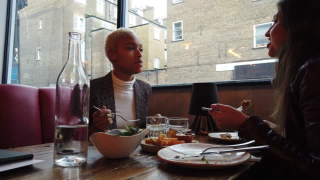Londoners women eating together at a restaurant video