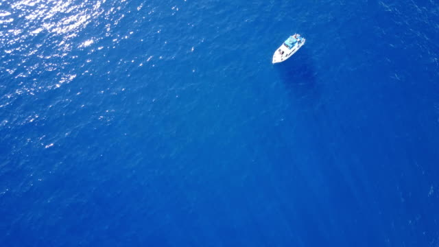 Lone Boat Floating Far Below Vantage of Drone off Maui Coast Maui,Boat - Flying, Tourist pacific islands stock videos & royalty-free footage