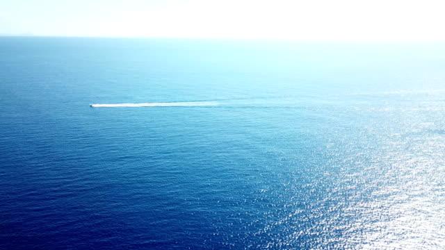 Lone Boat Traveling Across Vast Expanse of Ocean Off Maui Coast video