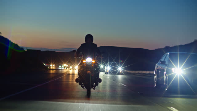 Lone Motorcyclist Riding Down the Moorpark Freeway At Sunset video