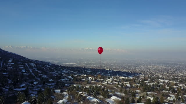 Lone Red Balloon Floating High Over City Stock Video - Download ...
