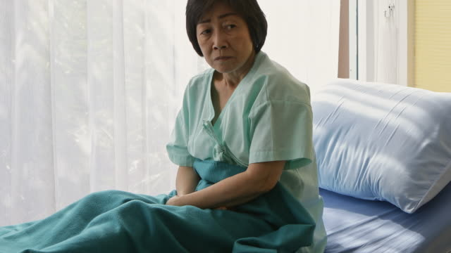 Lonely Elderly patients in hospital bed.