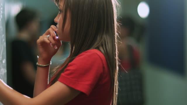 Lonely girl at locker. video