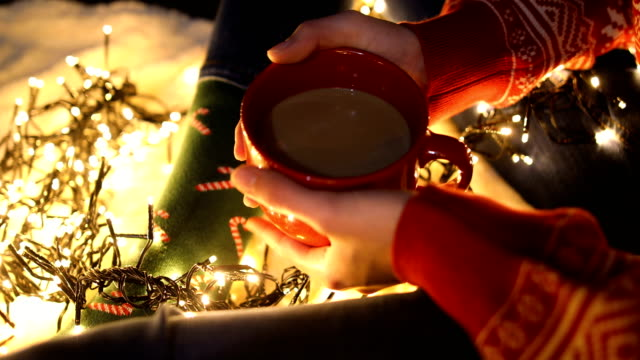 Lonely girl holding a coffee cup on Christmas eve