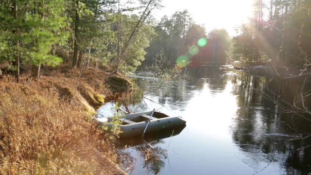 A lonely inflatable boat near the shore video