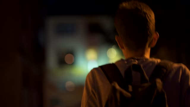 lonely man using night for relaxation - solo un uomo giovane video stock e b–roll