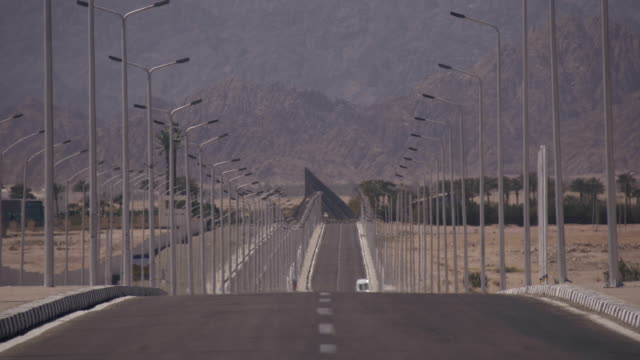 Lonely road near the desert mountains video