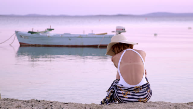 DS Lonely woman sitting on the beach video