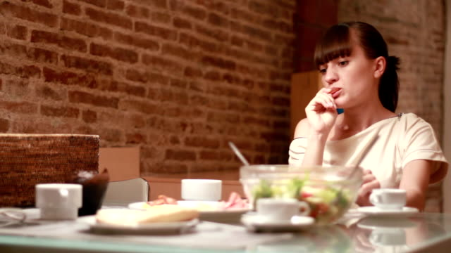 Lonely young woman sitting by the table video