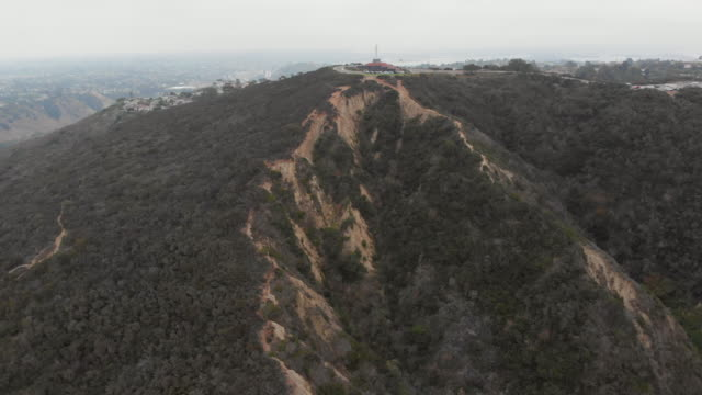 long aerial shot flying towards and over mt. soledad in san diego, california - temptation stock videos & royalty-free footage