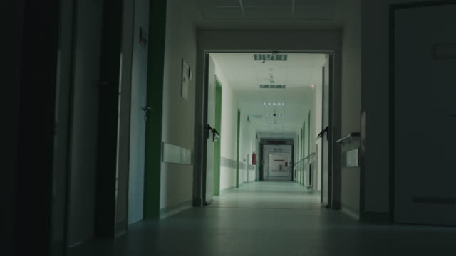 Long and dark hospital hallway video