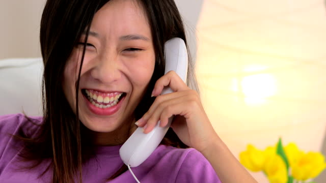 Long distance call to Chinese woman close-up, head and shoulders landline phone stock videos & royalty-free footage