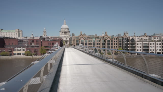 A long dolly shot over the Millennium footbridge towards St Paul's Cathedral, London