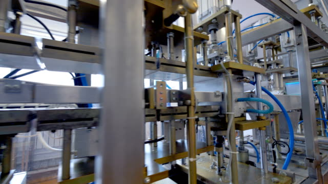 A long factory production line for sour cream filling and packing. video