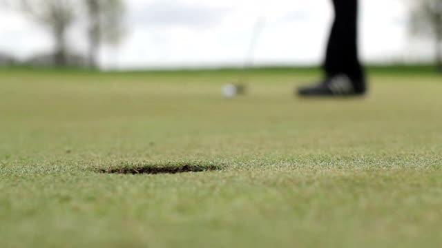 Long Golf Putt into Hole video