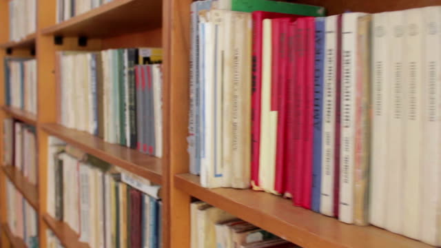 Long hall of library with wooden bookcases video