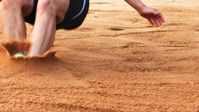 Long Jumper Landing In Sand video