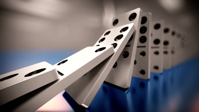 Long line of dominoes falling. Loopable CG anmation. video