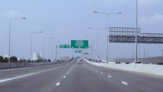 long road expressway view shooting from car driver view bangkok Thailand video