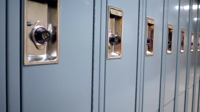 Long row of lockers in high school hallway