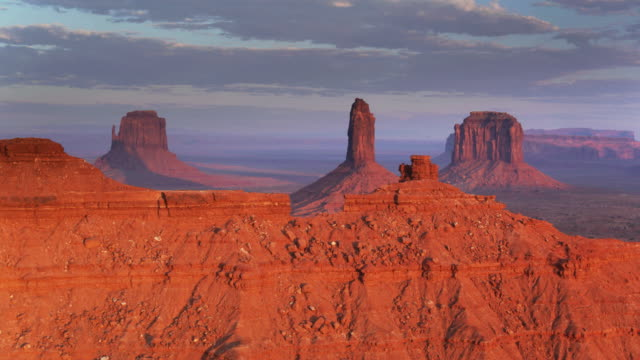 Long Shadows at Sunset in Monument Valley - Aerial Shot Drone shot of Monument Valley, the iconic cluster of sandstone buttes in the Navajo Nation Reservation. western usa stock videos & royalty-free footage
