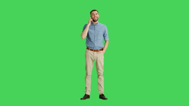 Long Shot if a Handsome Man Talking on a Headset. Shot on Green Screen Background. video
