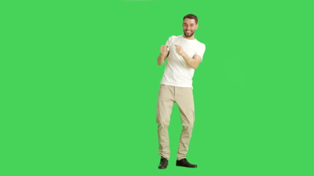 Long Shot of a Casual Man Dancing. Shot on a Green Screen Background. video