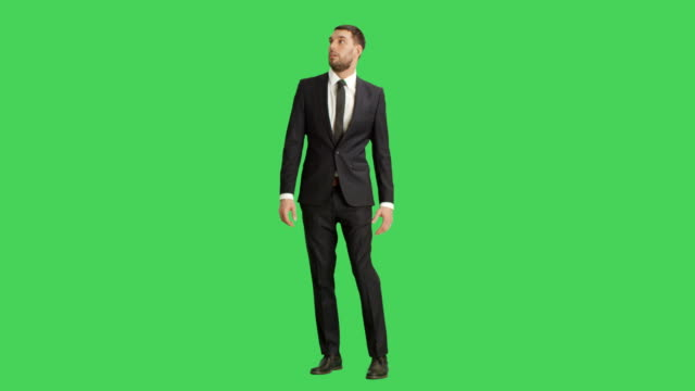 Long Shot of a Handsome Businessman Looking Around Frightened. Shot on a Green Screen Background. video