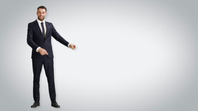Long Shot of a Handsome  Businessman Making Presenting/ Advertising/ Finger Guns Gesture. Then Putting Hands in Pockets. Shot with White Background. video