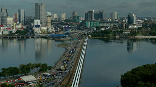 Long shot time lapse of a busy traffic at the Singapore causeway bridge Long shot of a busy traffic in time lapse at the Singapore causeway bridge johor bahru stock videos & royalty-free footage
