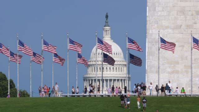 long slow motion establishing shot of capitol dome and washington monument - памятник стоковые видео и кадры b-roll