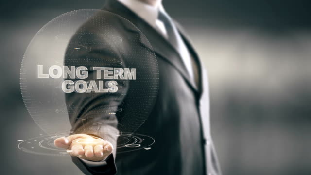 vídeos y material grabado en eventos de stock de largo plazo metas con concepto de empresario de holograma - largo longitud