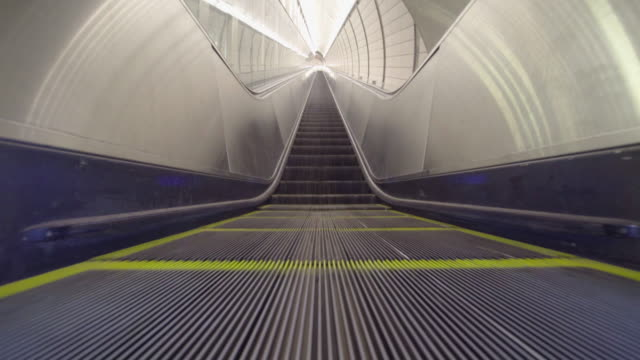 long view of vanishing perspective escalator from low angle. - escalator video stock e b–roll