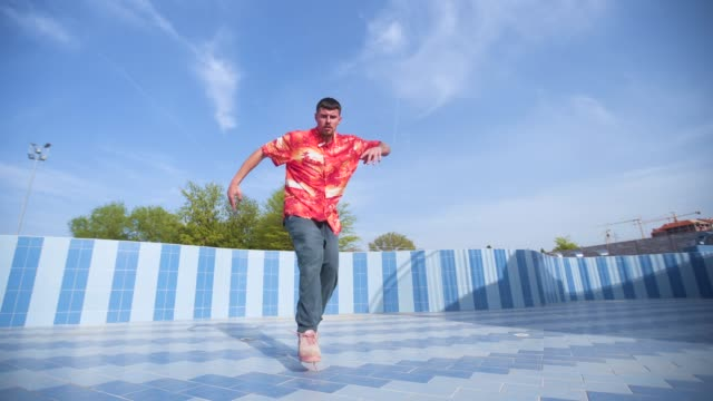Look at my dance skill Young man dancing in the empty swimming pool hip hop stock videos & royalty-free footage