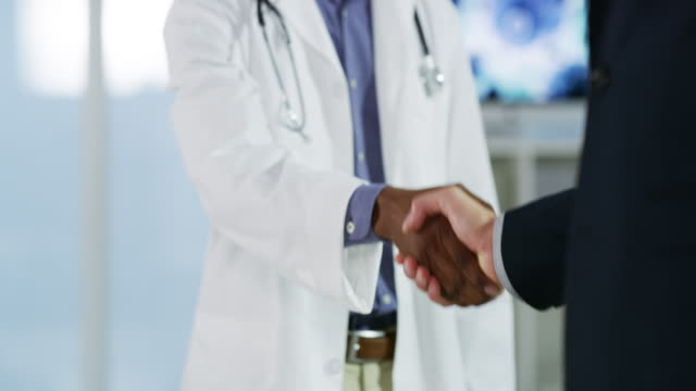 I look forward to future business endeavours with you 4k video footage of an unrecognizable young male doctor shaking hands with a businessman in a hospital employee engagement stock videos & royalty-free footage