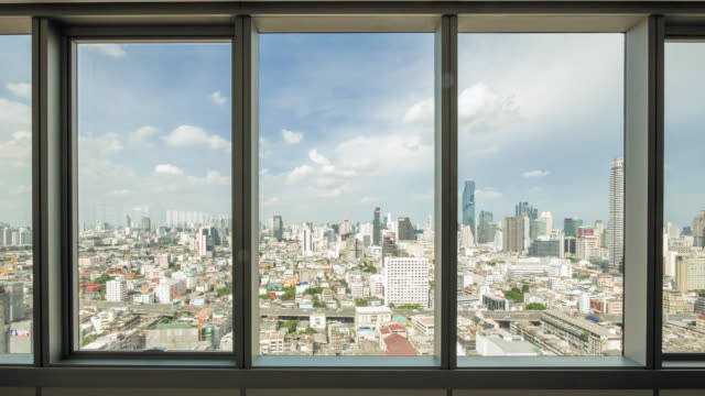 Look through the city and traffic view in Bangkok from office window