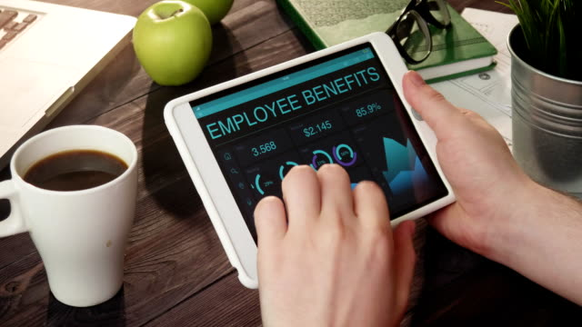 Looking at employee benefits records using digital tablet