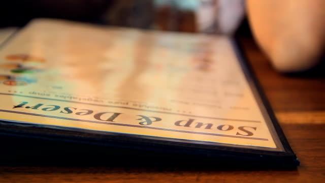 Looking at menu in cafe video